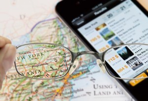 istock_rf_photo_of_reading_glasses_and_map